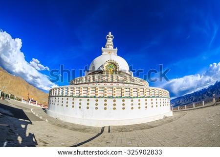 Shanti Stupa against blue sky and white cloud, leh Ladakh, India - stock photo