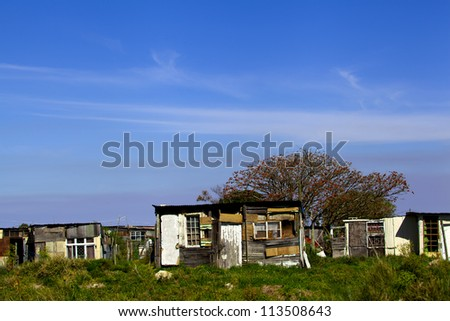 Shanty town. Shanty town house in South Africa with a big blue sky above to signify hope. - stock photo