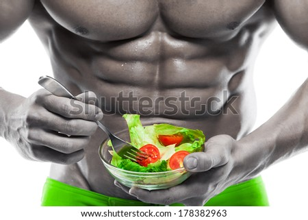 Shaped and healthy body man holding a fresh salad bowl,shaped abdominal, isolated on white background, colored retouched - stock photo