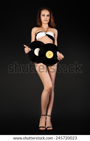 Shapely Woman DJ with two Vinyl Records. - stock photo