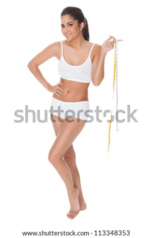 Shapely woman measuring her waist with a tape. Isolated on white - stock photo