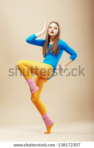 Shaping. Fitness. Active Shapely Woman in Sportswear on Tiptoe. Wellbeing - stock photo