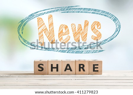 Share news word sign on a wooden table - stock photo