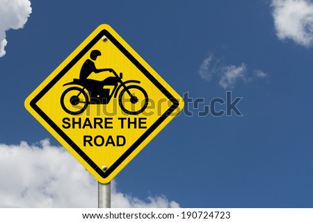 Share the Road Warning Sign, An road warning sign with words Share the Road and a motorcycle icon with blue sky background - stock photo