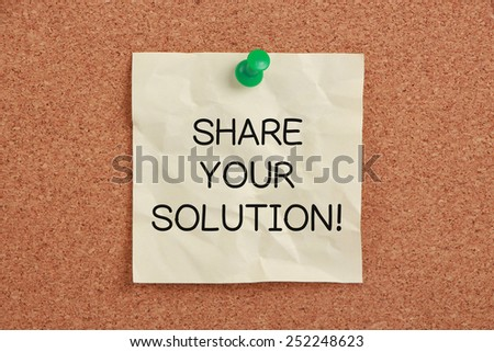 Share Your Solution sticky note pinned on cork. - stock photo
