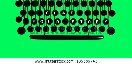 Share your story spelled on a vintage keyboard on green - stock photo