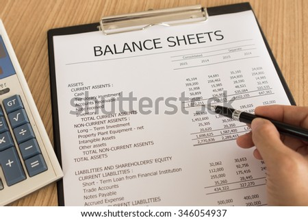 Shareholders analyzing financial statements to view the prospects for business growth. - stock photo