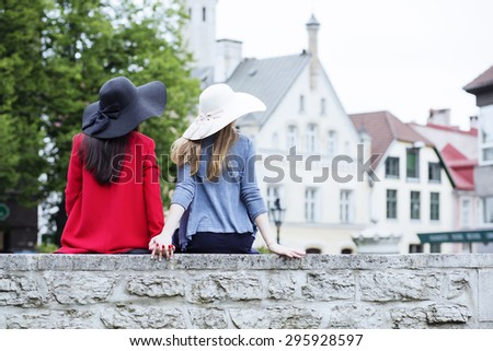 Sharing a moment in the medieval town - stock photo