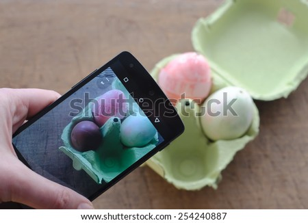 Sharing Picture of Easter Present by Smart Phone - stock photo