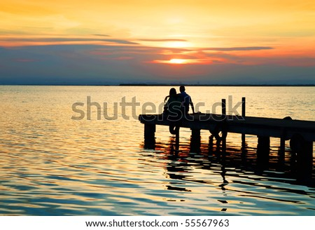 sharing the sunset - stock photo
