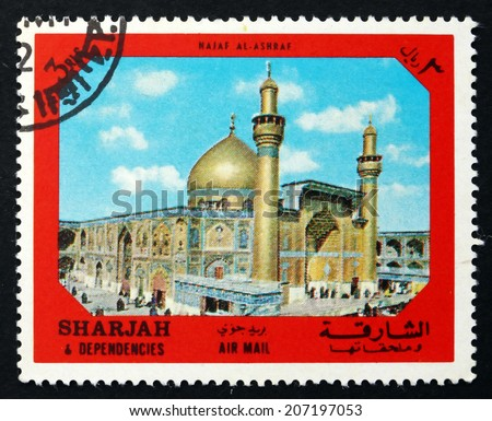 SHARJAH - CIRCA 1972: a stamp printed in the Sharjah UAE shows Holy City of Najaf al Ashraf, Ancient City of the Middle East, circa 1972 - stock photo
