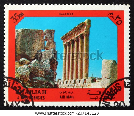 SHARJAH - CIRCA 1972: a stamp printed in the Sharjah UAE shows Ruins of Baalbeck Temple, Ancient City of the Middle East, circa 1972 - stock photo
