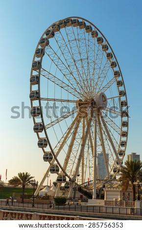 SHARJAH, UAE - OCTOBER 28, 2013: Eye of the Emirates - ferris wheel in Al Qasba in Shajah, UAE - stock photo