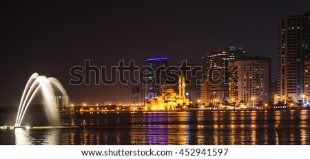 SHARJAH, UAE - OCTOBER 29, 2013: Musical fountain show. The Sharjah Fountain is one of the biggest fountains in the region. - stock photo