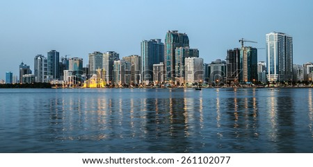SHARJAH, UAE - OCTOBER 29, 2013: Night view of Sharjah, Sharjah is located along northern coast of Persian Gulf on Arabian Peninsula - stock photo