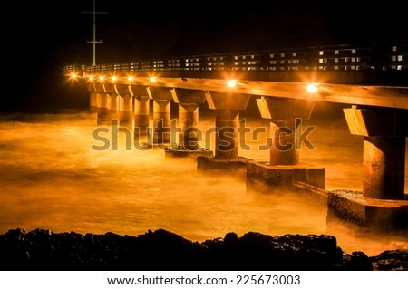 Shark Rock Pier in Port Elizabeth South Africa at night - stock photo