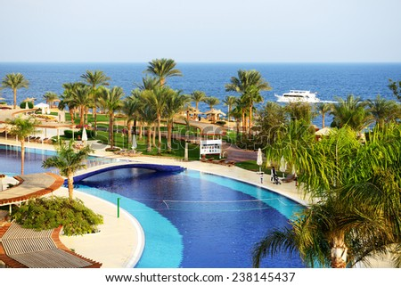 SHARM EL SHEIKH, EGYPT -  DECEMBER 3: The tourists are on vacation at popular hotel on December 3, 2013 in Sharm el Sheikh, Egypt. Up to 12 million tourists have visited Egypt in year 2013. - stock photo