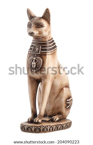 Sharm El Sheikh, Egypt - February 2, 2014: Cat statue toy isolated on white background. Made of stone figure. - stock photo