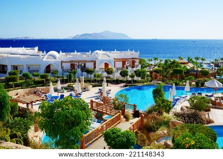 SHARM EL SHEIKH, EGYPT -  NOVEMBER 28: The tourists are on vacation at popular hotel on November 28, 2012 in Sharm el Sheikh, Egypt. Up to 12 million tourists have visited Egypt in year 2012. - stock photo