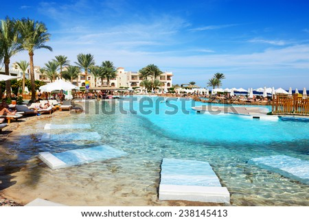SHARM EL SHEIKH, EGYPT -  NOVEMBER 29: The tourists are on vacation at popular hotel on November 29, 2013 in Sharm el Sheikh, Egypt. Up to 12 million tourists have visited Egypt in year 2013. - stock photo