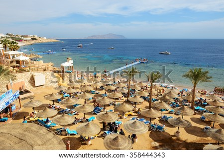 SHARM EL SHEIKH, EGYPT -  NOVEMBER 30: The tourists are on vacation at popular hotel on November 30, 2013 in Sharm el Sheikh, Egypt. Up to 12 million tourists have visited Egypt in year 2013. - stock photo