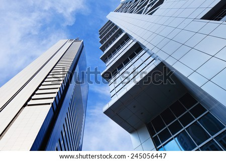 Sharp lines from modern architecture against a blue sky. - stock photo