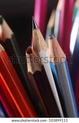 Sharp Pencil Standing Out From Broken Pencils - stock photo
