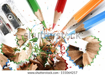 Sharpened pencil and wood shavings. - stock photo