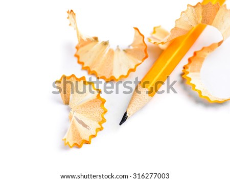 Sharpened pencil and wood shavings isolated - stock photo