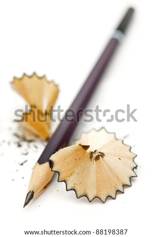 sharpened pencil shavings with a white background vertical - stock photo