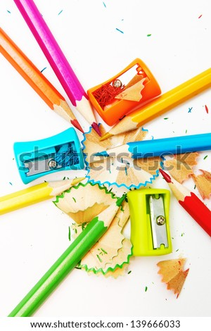 Sharpened pencils and wood shavings - stock photo