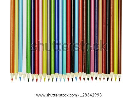 Sharpened pencils laying side by side on a white background. - stock photo