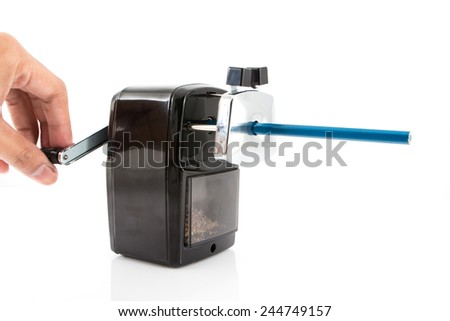 Sharpener and colorful pencil isolated on white background. - stock photo
