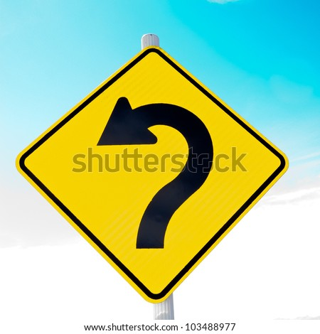 Sharply curving arrow on road sign pointing left in a concept of turning around, correction and betterment - stock photo