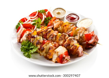 Shashlik - grilled meat and vegetables  - stock photo