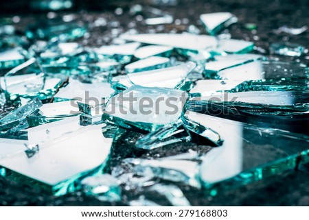Shattered and splitted glass Pieces. Glass texture - stock photo