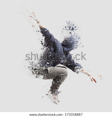 Shattered dancer.image of female dancer jumping. Shatterd and disolve effect added in Photoshop.  - stock photo