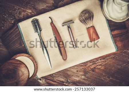 Shaving accessories on a luxury wooden background  - stock photo