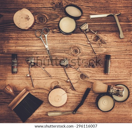 Shaving accessories on a on a luxury wooden board  - stock photo