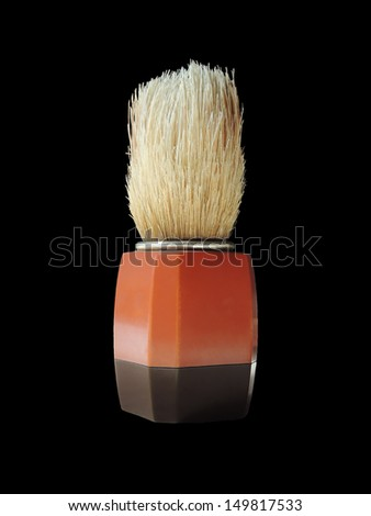 shaving-brush insulation on a black background closeup - stock photo