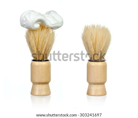 Shaving brushes over white background. One with foam on top - stock photo