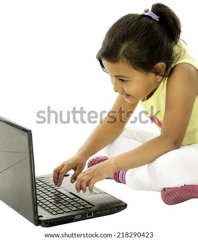 She is a cute girl who is studing and looking the computer. - stock photo