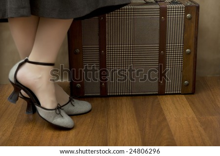 she is going to traveling with her bags and maps - stock photo