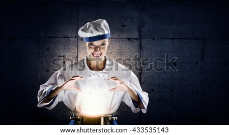 She is magician as cook - stock photo