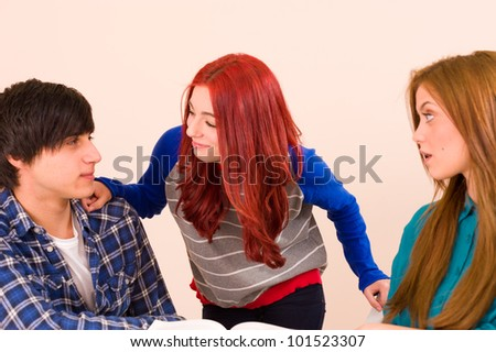She is sparking a flirt in class - stock photo