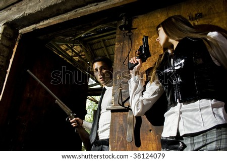 she is waiting with gun - stock photo