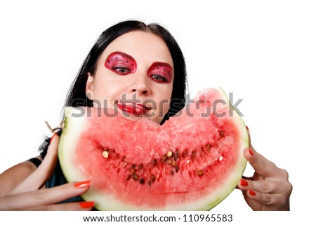 she licks her lips looking at the watermelon isolated - stock photo