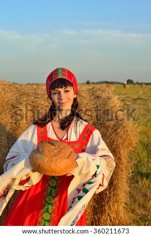 She meets with bread on rushnyk - stock photo