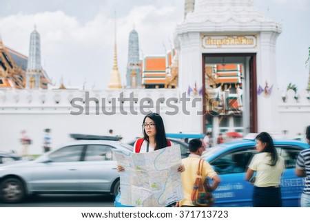 she viewing the map in bangkok - stock photo