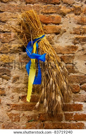 Sheaf of wheat. Sign outside a Tuscan bakery front door in the medieval town of San Gimignano - stock photo